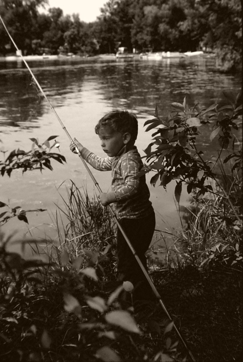 Little boy fishing circa 1970 with cane pole for Little girl fishing pole